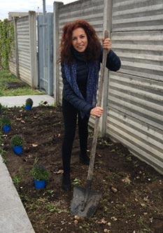 Tatiana planting flowers for Earth Day in Ossana