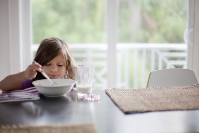 World Food Day child eating cereal