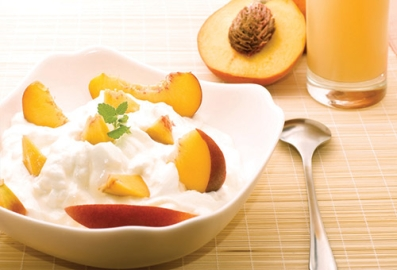 Bowl of yoghurt with peaches