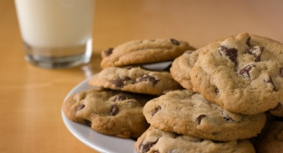 Plate of cookies with milk in the background