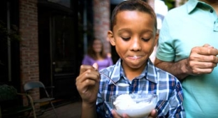 Child with bowl of ice cream
